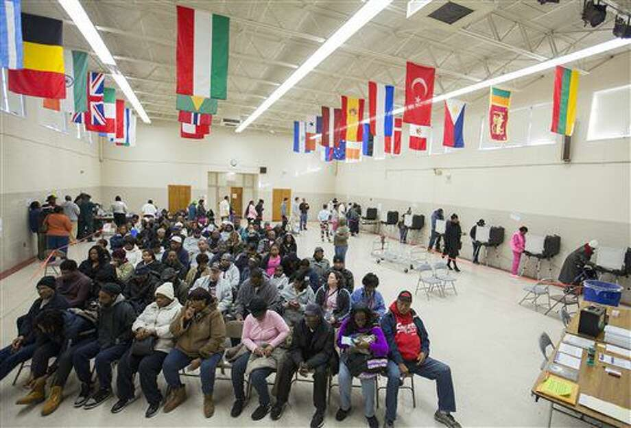 Voters sit in rows of chairs at Rosemont Middle School as they wait their turn to cast their ballots on Election Day in Norfolk, Va., Tuesday, Nov. 8, 2016. (Bill Tiernan/The Virginian-Pilot via AP) Photo: Bill Tiernan