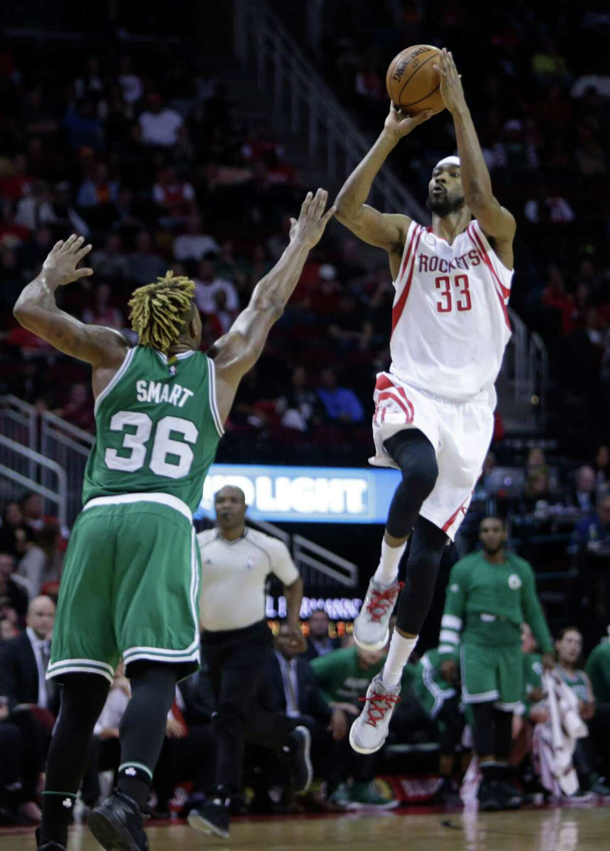 Houston Rockets forward Corey Brewer (33) shoots over Boston Celtics guard Marcus Smart (36) during the Rockets game against the Boston Celtics at Toyota Center, Monday, Dec. 5, 2016, in Houston.