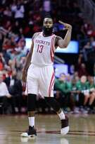 Houston Rockets guard James Harden (13) celebrates the three pointer that game the Rockets a five-point lead near the end of the Rockets game against the Boston Celtics at Toyota Center, Monday, Dec. 5, 2016, in Houston.
