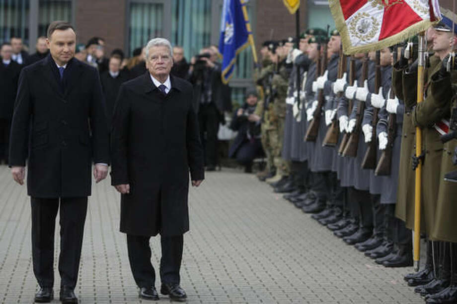 Polish President Andrzej Duda, left, and German President Joachim Gauck, 2. from left, review the honor guards during a visit to the Headquarters of the Multinational Corps Northeast of the NATO, in Szczecin, Poland, Monday, Nov. 28, 2016. (AP Photo/Markus Schreiber) Photo: Markus Schreiber