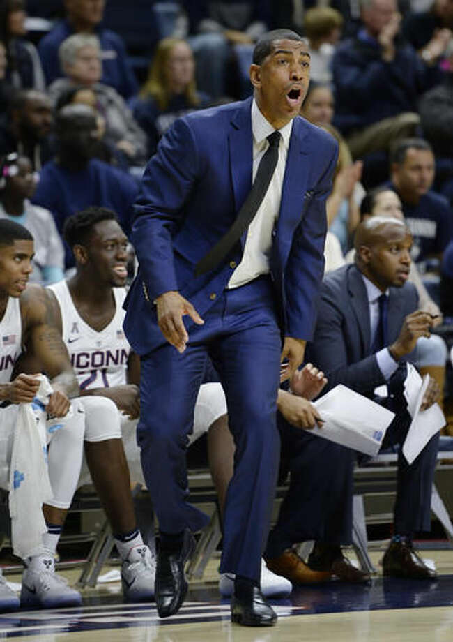 FILE: Connecticut coach Kevin Ollie calls out to his team during the first half of an NCAA college basketball game against Wagner, Friday, Nov. 11, 2016, in Storrs, Conn. (AP Photo/Jessica Hill) Photo: Jessica Hill