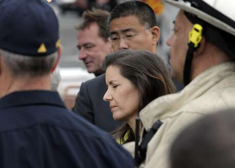 Oakland Mayor Libby Schaaf closes her eyes as Alameda County District Attorney Nancy O'Malley addresses the press as recovery efforts continue following the Ghost Ship fire that has so far claimed 36 lives in Oakland, Calif., on Monday, December 5, 2016.
