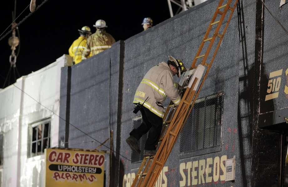 Fire Department crews make structural inspections during recovery efforts after the Ghost Ship warehouse fire in Oakland. Photo: Carlos Avila Gonzalez, The Chronicle