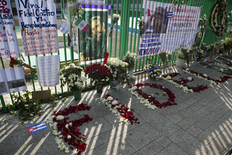 Flower petals spell out Fidel, in front of messages and flowers left by supporters of late Cuban President Fidel Castro, outside the Cuban Embassy in Mexico City, Sunday, Nov. 27, 2016. Castro, who led a rebel army to improbable victory, embraced Soviet-style communism and defied the power of 10 U.S. presidents during his half century rule of Cuba, died at age 90 in Cuba late Friday. (AP Photo/Rebecca Blackwell) Photo: Rebecca Blackwell