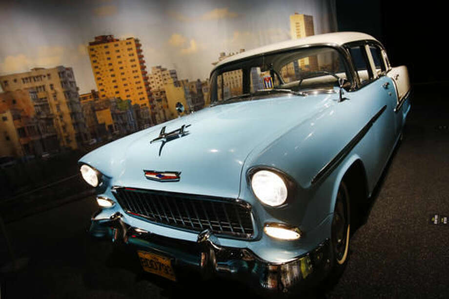 """A 1955 Chevrolet Bel Air is displayed in the exhibit """"Cuba!"""" at the American Museum of Natural History, Tuesday, Nov. 15, 2016, in New York. The show of Cuban biodiversity, people and culture opens Monday, Nov. 21. It was produced with the collaboration of the Cuban National Museum of Natural History. (AP Photo/Mark Lennihan) Photo: Mark Lennihan"""