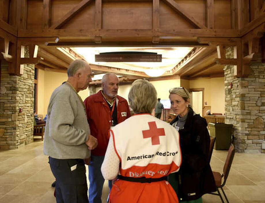 Red Cross officials and volunteers, from left, John Manners, Louie Keeling, Kathleen Manners and Sharon Hudson, confer at the LeConte Center Wednesday, Nov. 30, 2016, in Pigeon Forge, Tenn., which has been serving as a Red Cross shelter since the wildfires in Pigeon Forge and Gatlinburg. (Amy Smotherman Burgess/Knoxville News Sentinel via AP) Photo: Amy Smotherman Burgess