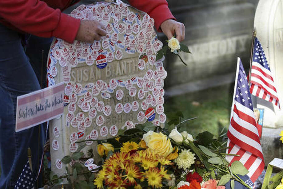 "Voters lined up on Election Day to place ""I voted"" stickers on the grave of Susan B. Anthony at Mt. Hope Cemetery in Rochester, NY., Tuesday, Nov. 8, 2016. (Max Schulte /Democrat & Chronicle via AP) Photo: Max Schulte"