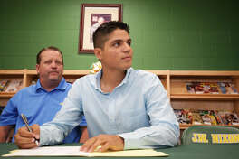 Nixon's Joe Fasulo signs his letter of intent Wednesday to play baseball at Texas A&M International University.