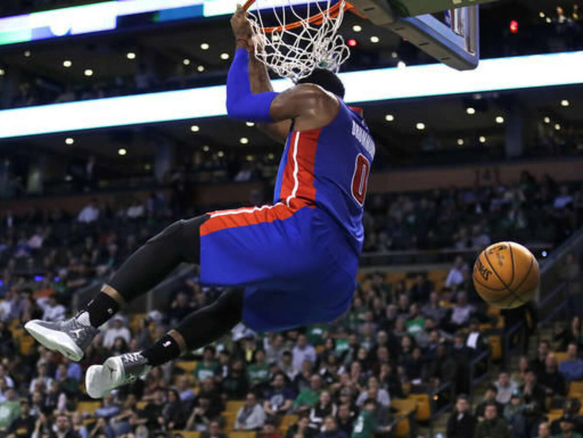 Detroit Pistons center Andre Drummond (0) hangs on the rim after slamming a dunk during the second half of an NBA basketball game against the Boston Celtics in Boston, Wednesday, Nov. 30, 2016. Drummond scored 20 points as the Pistons defeated the Celtics 121-114. (AP Photo/Charles Krupa)