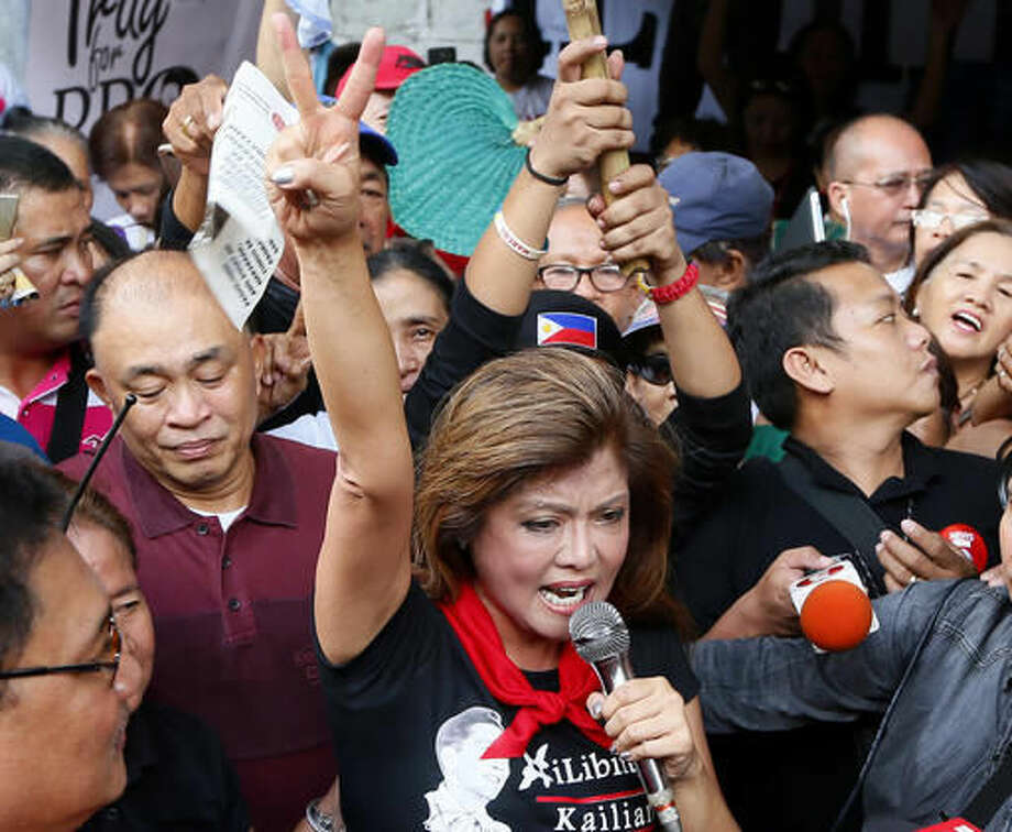 "Governor Imee Marcos, the eldest daughter of the late Philippine dictator Ferdinand Marcos, flashes a victory sign after the Philippine Supreme Court voted 9-5, with one abstention, to rule that the former dictator can be buried at the heroes' cemetery in a ruling opponents say rolled back the country's democratic triumph when Filipinos ousted the strongman in a 1986 ""people power"" revolt Tuesday, Nov.8, 2016 in Manila, Philippines. Court spokesman Theodore Te says the 15-member court voted 9-5 with one abstention Tuesday to dismiss petitions opposing President Rodrigo Duterte's approval of Marcos's burial at the cemetery. (AP Photo/Bullit Marquez) Photo: Bullit Marquez"