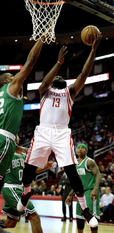 Houston Rockets' James Harden (13) goes up for a shot as Boston Celtics' Al Horford, left, defends during the first quarter of an NBA basketball game, Monday, Dec. 5, 2016, in Houston. (AP Photo/David J. Phillip) Photo: David J. Phillip, STF / Copyright 2016 The Associated Press. All rights reserved.
