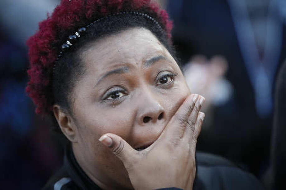 Protestor Alethia Finley wipes tears from her eyes as demonstrators gather for a rally in Washington Park after a mistrial was declared due to a hung jury in the murder trial against Ray Tensing, Saturday, Nov. 12, 2016, in Cincinnati. Tensing, a white former University of Cincinnati police officer, was charged with murder in the shooting of Sam DuBose, an unarmed black motorist, while on duty during a routine traffic stop on July 19, 2015. (AP Photo/John Minchillo) Photo: John Minchillo