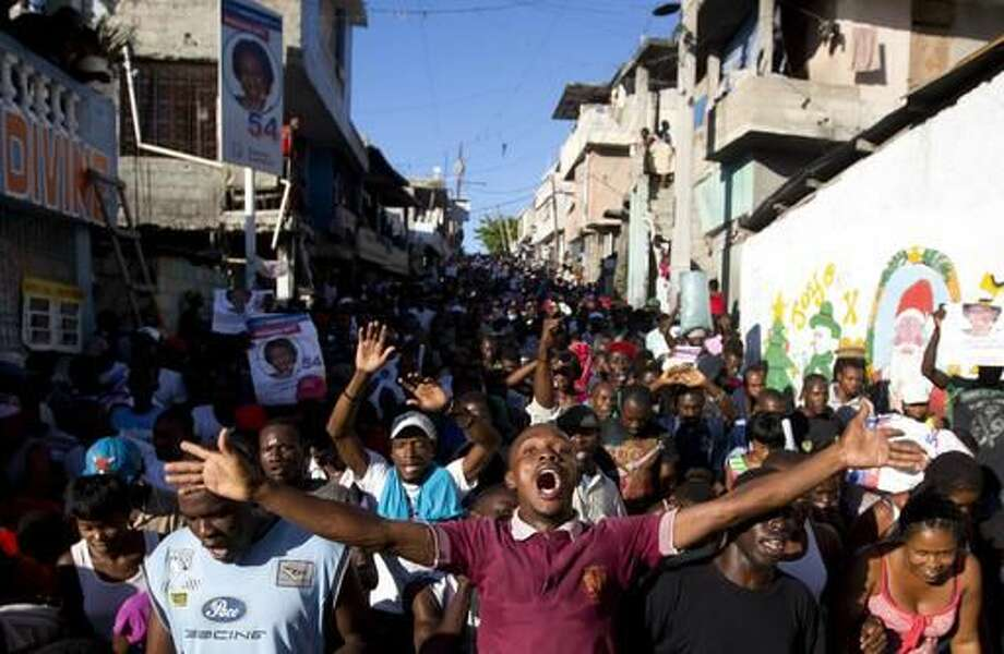 Supporters of presidential candidate Maryse Narcisse, from Fanmi Lavalas political party, chant victory slogans during a protest in Port-au-Prince, Haiti, Monday, Nov. 28, 2016. Before election results have been announced, supporters of Narcisse assert their candidate has won, and that only electoral fraud would keep her from office. (AP Photo/Dieu Nalio Chery) Photo: Dieu Nalio Chery