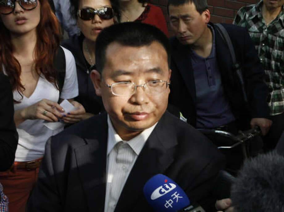 FILE - In this May 2, 2012 file photo, Human rights activist Jiang Tianyong speaks to journalists outside a hospital after his failed attempt to see blind Chinese activist Chen Guangcheng who is believed to be seeking treatment in Beijing, China. The wife of one of China's most prominent human rights campaigners says he has disappeared during a trip to visit relatives of a detained rights lawyer. Jin Bianling said Thursday, Nov. 24, 2016, that her husband Jiang Tianyong, a legal activist, has not been heard from since Monday, when he was due to board a train to return to Beijing.(AP Photo/Ng Han Guan, File) Photo: Ng Han Guan