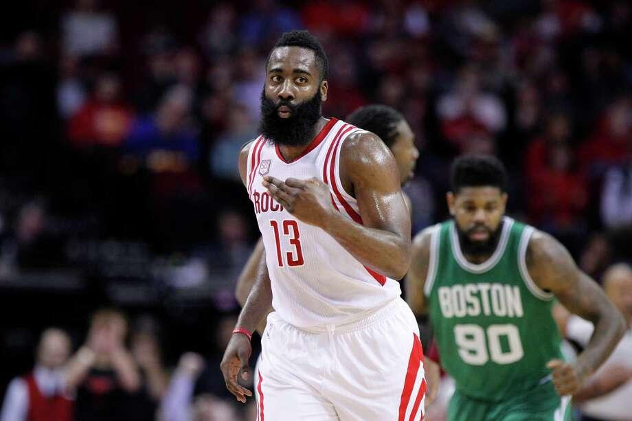 Houston Rockets guard James Harden (13) celebrates a three pointer during the Rockets game against the Boston Celtics at Toyota Center, Monday, Dec. 5, 2016, in Houston. ( Mark Mulligan / Houston Chronicle ) Photo: Mark Mulligan, Staff / © 2016 Houston Chronicle
