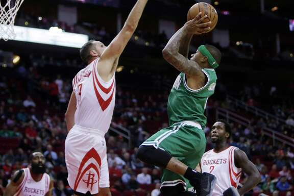 Houston Rockets forward Ryan Anderson (3) tries to stop Boston Celtics guard Isaiah Thomas (4) during the Rockets game against the Boston Celtics at Toyota Center, Monday, Dec. 5, 2016, in Houston. ( Mark Mulligan / Houston Chronicle )