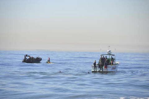 The Latest: Missing diver's body found near Manhattan Beach