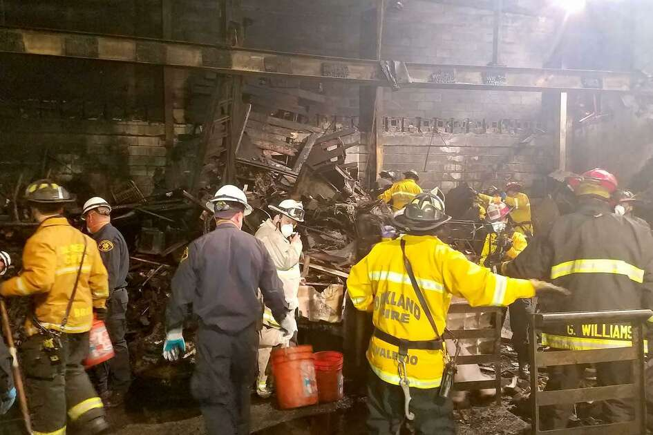 This photo provided by the City of Oakland shows inside the burned warehouse after the deadly fire that broke out on Dec. 2, 2016, in Oakland, Calif. The death toll in the fire climbed Monday, Dec. 5, with more bodies still feared buried in the blackened ruins, and families anxiously awaited word of their missing loved ones.