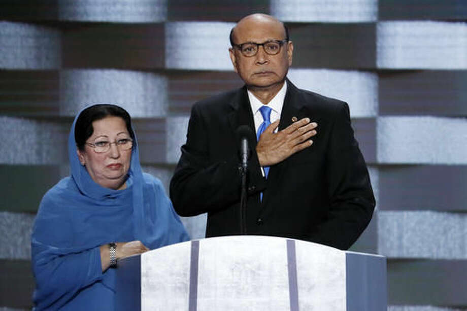 In this July 28, 2016, file photo, Khizr Khan, father of fallen Army Capt. Humayun Khan and his wife Ghazala speak during the final day of the Democratic National Convention in Philadelphia. Photo: J. Scott Applewhite