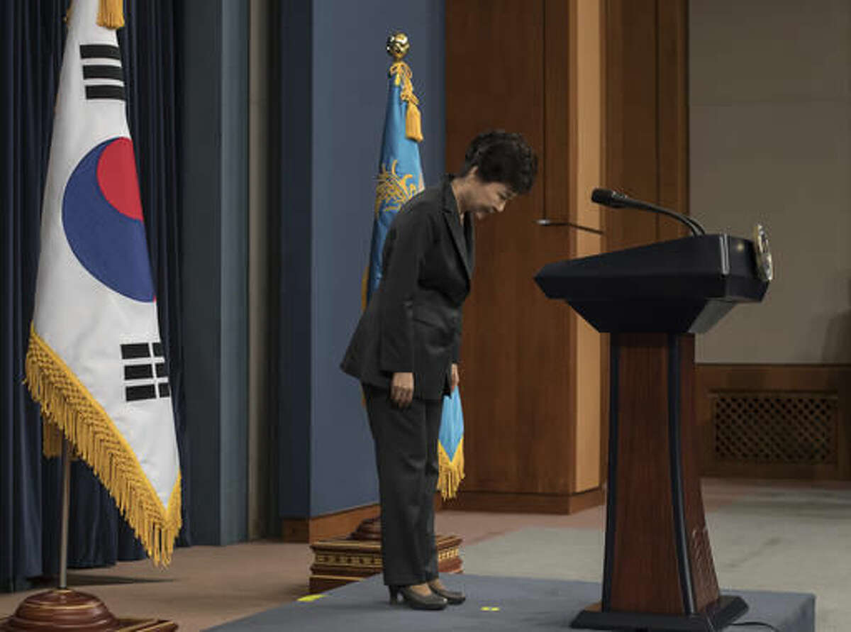 """FILE - In this Friday, Nov. 4, 2016 file photo, South Korean President Park Geun-hye bows before addressing the nation over a """"heartbreaking"""" scandal at the presidential Blue House in Seoul. South Korean prosecutors are likely to question Park over suspicion that she let a shadowy longtime confidante manipulate power from behind the scenes, state-run Yonhap news agency reported Sunday, Nov. 13. (Ed Jones/Pool Photo via AP, File)"""