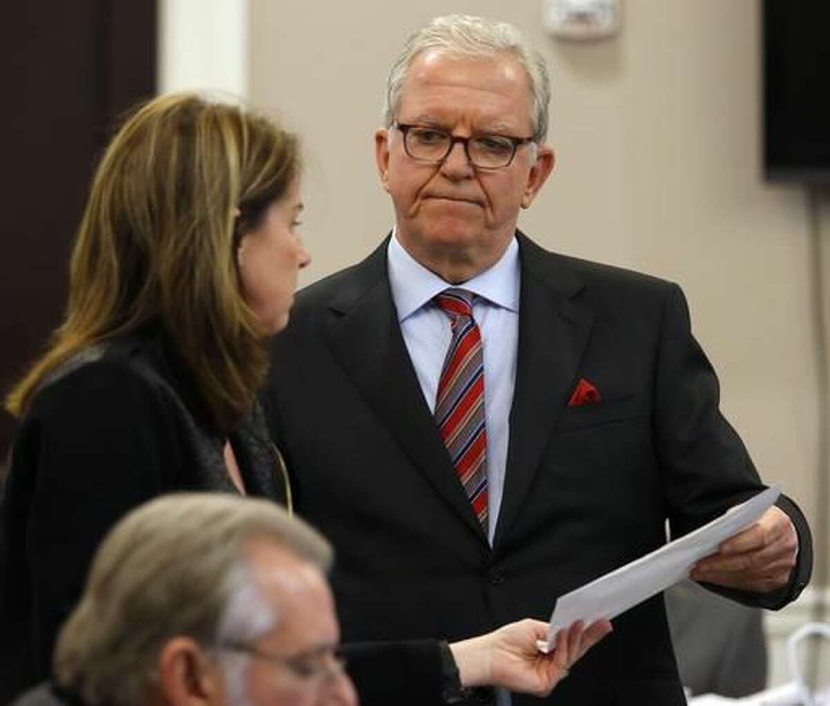 Defense attorney Andy Savage, right, speaks with Ninth Circuit Solicitor Scarlett Wilson in court during the murder trial of former North Charleston police officer Michael Slager at the Charleston County court in Charleston, S.C., Monday, Nov. 28, 2016. A judge is considering whether jurors will visit the spot where a white former South Carolina police officer is accused of shooting and killing an unarmed black man in North Charleston. (Grace Beahm/Post and Courier via AP, Pool)