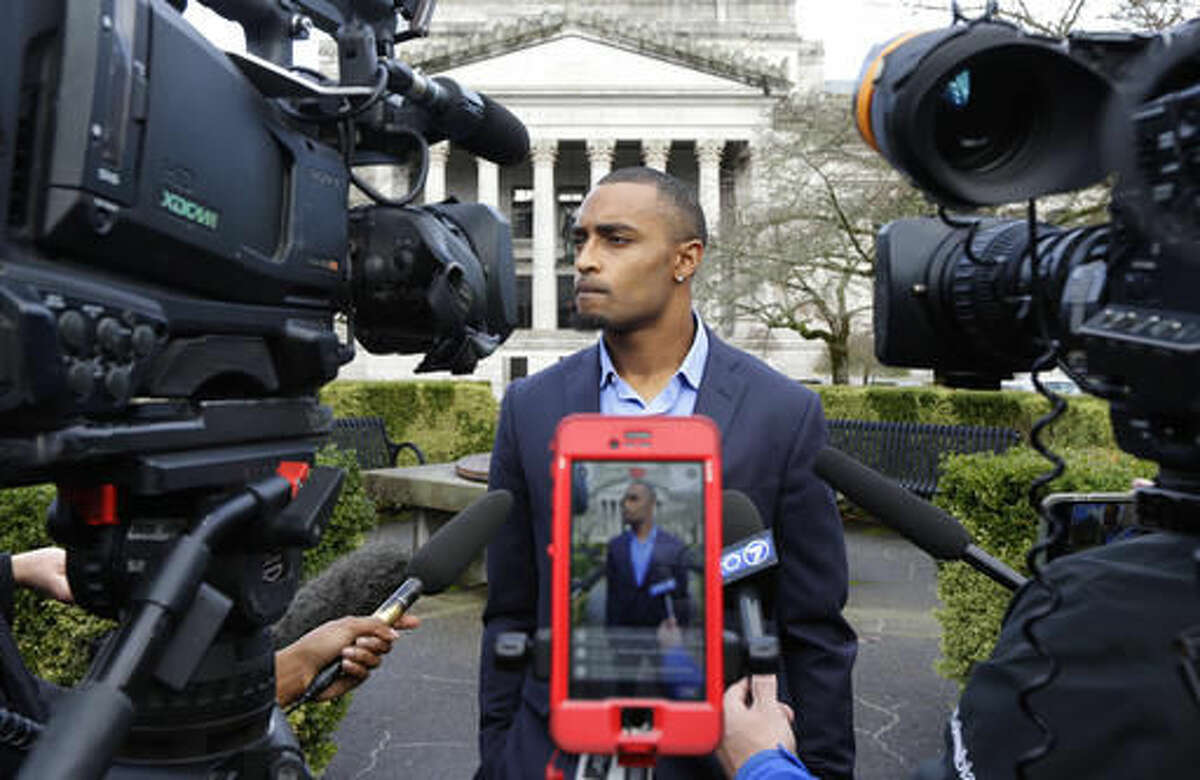 Seattle Seahawks NFL football wide receiver Doug Baldwin talks to reporters Monday, Nov. 21, 2016, after he testified at a joint legislative task force on the use of deadly force in community policing at the Capitol in Olympia, Wash. Baldwin, whose father was a police officer, has been outspoken on the issues of police training, racial profiling, and the use of force by law enforcement officers. (AP Photo/Ted S. Warren)
