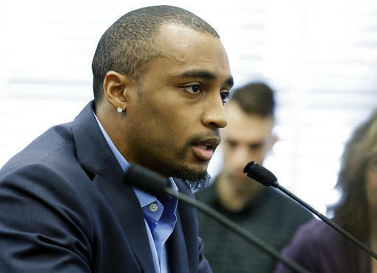 Seattle Seahawks NFL football wide receiver Doug Baldwin speaks Monday, Nov. 21, 2016, to a joint legislative task force on the use of deadly force in community policing, at the Capitol in Olympia, Wash. Baldwin, whose father was a police officer, has been outspoken on the issues of police training, racial profiling, and the use of force by law enforcement officers. (AP Photo/Ted S. Warren)