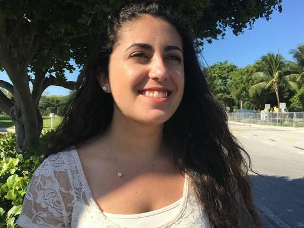 Isabella Prio, 20, a Cuban-American student at Boston College from Miami, poses for a photo Sunday, Nov. 27, 2016, in Miami. Prio has never been to the country where her grandfather was once president and refuses to visit until it¹s a democracy. For the hundreds of thousands of children born of Cuban exiles, some who are two and three generations removed from the island, Fidel Castro's death potentially opens a door to a world previously off-limits. (AP Photo/Tamara Lush)