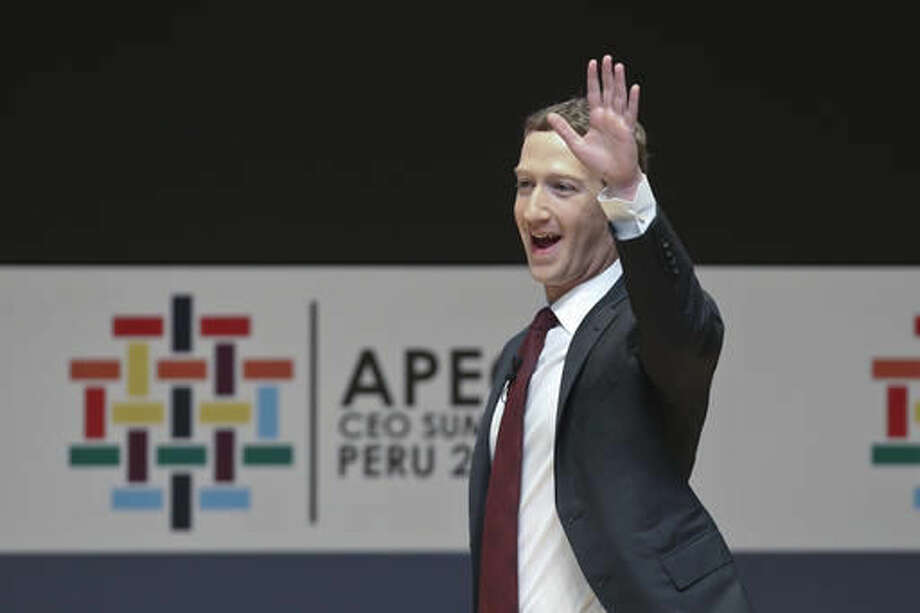 Mark Zuckerberg, chairman and CEO of Facebook, waves during a speech at the CEO summit during the annual Asia Pacific Economic Cooperation (APEC) forum in Lima, Peru, Saturday, Nov. 19, 2016. (AP Photo/Esteban Felix) Photo: Esteban Felix