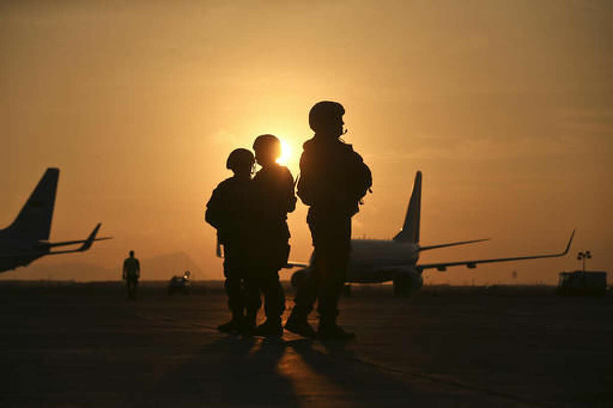 Soldiers guard the military airport during the arrival of leaders that will participate in the APEC summit in Lima, Peru, Friday, Nov. 18, 2016. (AP Photo/Esteban Felix)