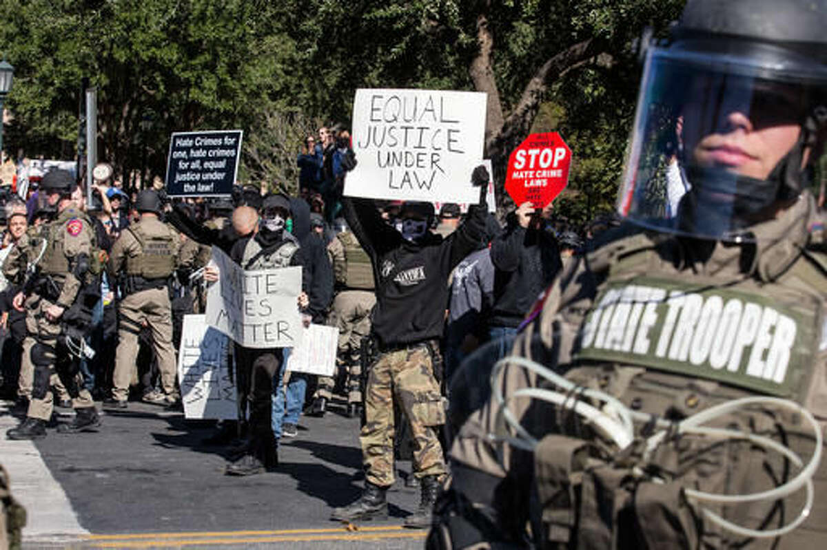 Police in riot gear hold counter-protestors away from a White Lives Matter rally in front of the Texas State Capitol in Austin, Texas, on Saturday, Nov. 19, 2016. Earlier in the day, officials unveiled a monument recognizing the contributions of African-Americans to the state. (Dave Creaney/Austin American-Statesman via AP)