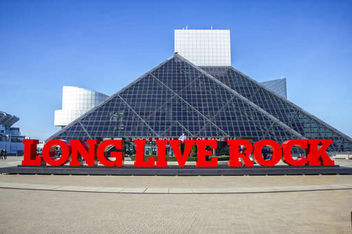 """This photo provided by Rock & Roll Hall of Fame shows the new """"Long Live Rock"""" sign outside the Rock and Roll Hall of Fame in Cleveland. The outdoor sign will be formally dedicated Thursday, Nov. 10, 2016 as officials share details of a multimillion-dollar redesign expected to include the Hall of Fame and main exhibit spaces. (Carl Harp/Rock & Roll Hall of Fame via AP)"""