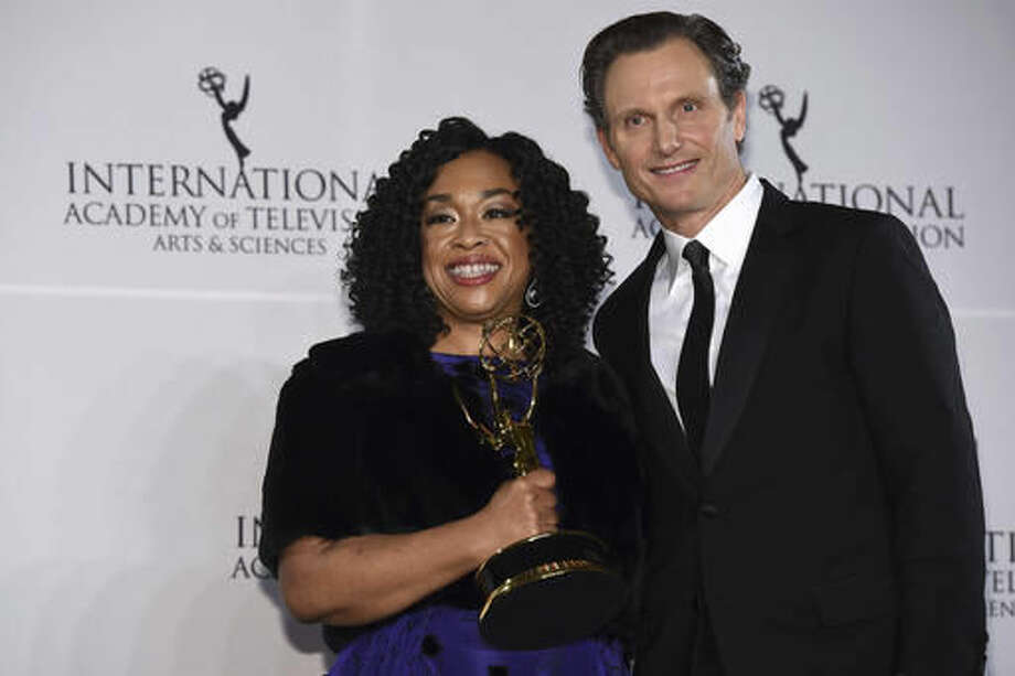 Shonda Rhimes, left, winner of the Founders Award and presenter Tony Goldwyn appear in the press room for the 44th International Emmy Awards at the New York Hilton on Monday, Nov. 21, 2016, in New York. (Photo by Charles Sykes/Invision/AP) Photo: Charles Sykes
