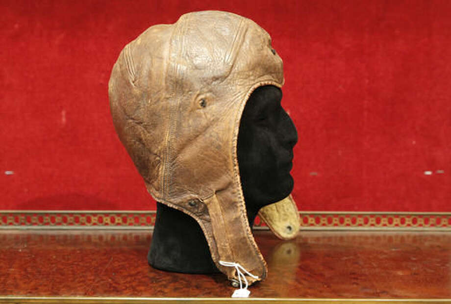 The leather cap of Captain Charles Lindbergh is pictured at the Drouot aucton house, Wednesday, Nov.16, 2016 in Paris. Lindbergh wore the aviation cap during his famous 33-hour transatlantic flight in 1927 from New York to Paris. Drouot's Wednesday sale is expected to fetch around $64 000-86 000. (AP Photo/Christophe Ena) Photo: Christophe Ena
