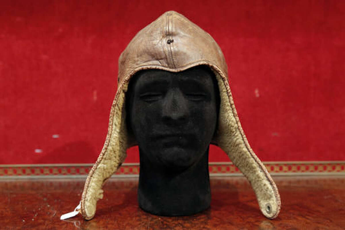 The leather cap of Captain Charles Lindbergh is pictured at the Drouot auction house, Wednesday, Nov.16, 2016 in Paris. Lindbergh wore the aviation cap during his famous 33-hour transatlantic flight in 1927 from New York to Paris. Drouot's Wednesday sale is expected to fetch around $64 000-86 000. (AP Photo/Christophe Ena)