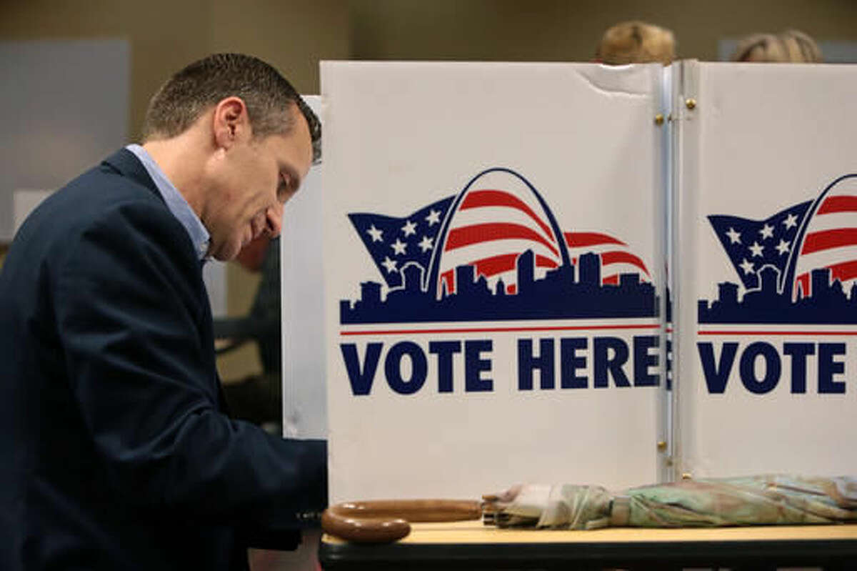 Republican gubernatorial candidate Eric Greitens makes his ballot selections at the St. Louis Public Library Schlafly branch in St. Louis on Tuesday, Nov. 8, 2016. (Cristina M. Fletes/St. Louis Post-Dispatch via AP)