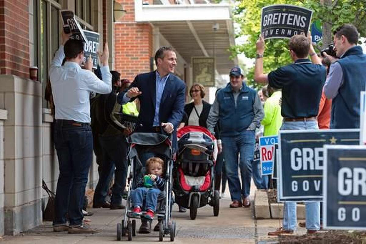 Republican gubernatorial candidate Eric Greitens with son, Joshua, makes his way to cast his vote at the St. Louis Public Library in St. Louis on Tuesday, Nov. 8, 2016. (Cristina M. Fletes/St. Louis Post-Dispatch via AP)