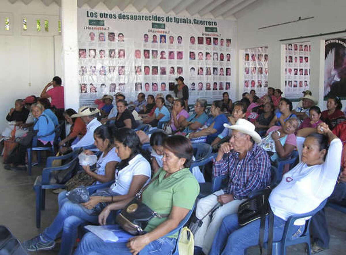 Relatives of the missing attend their weekly meeting in Iguala, Guerrero State, Mexico, Tuesday Nov. 22, 206. Iguala's collective of the Other Disappeared have had the remains of 18 relatives returned to them by authorities. Five more sets of remains have been identified and await transfer to their families, said Adriana Bahena Cruz, a representative of the group. (AP Photo/Chris Sherman)