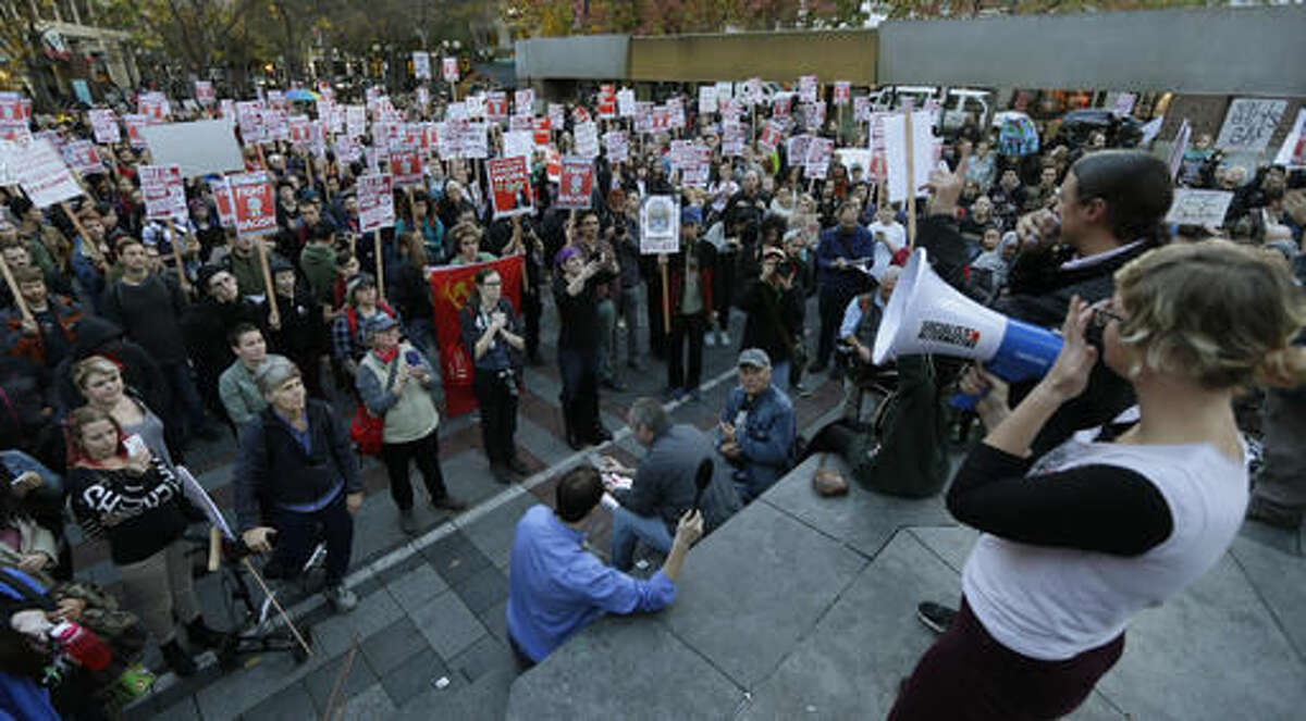 Hundreds of protesters take part in a protest against the election of President-elect Donald Trump, Wednesday, Nov. 9, 2016, in downtown Seattle. (AP Photo/Ted S. Warren)