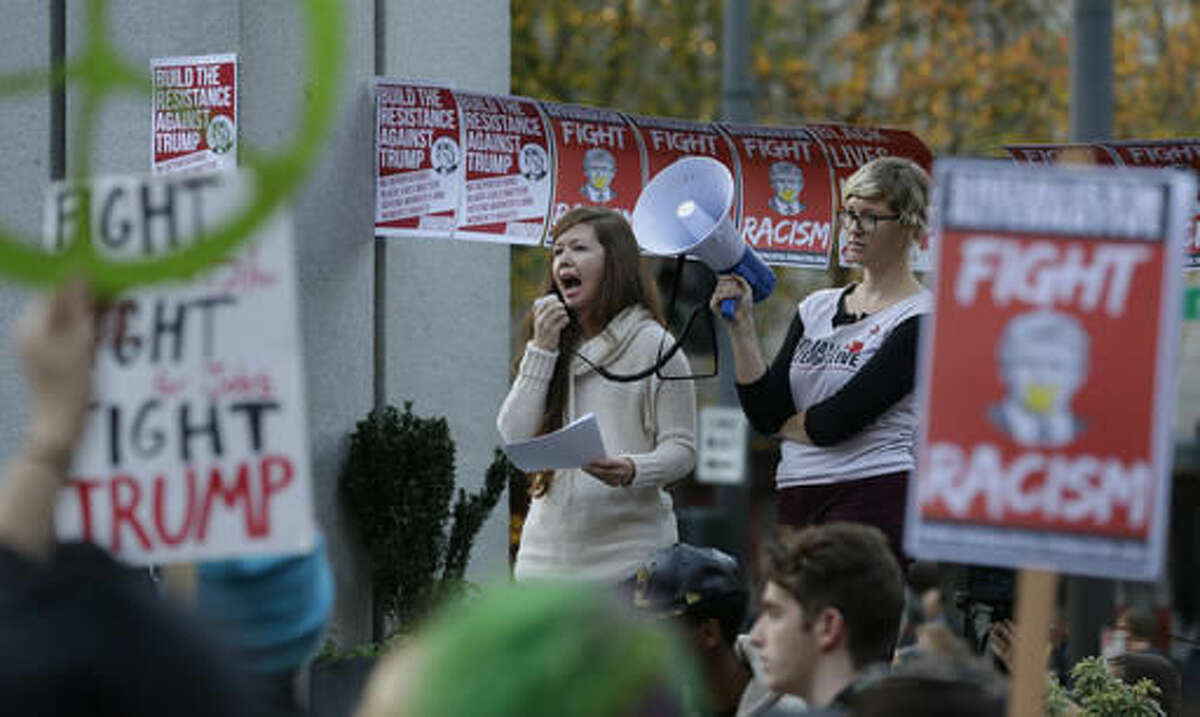 Protesters yell during a protest against the election of President-elect Donald Trump, Wednesday, Nov. 9, 2016, in downtown Seattle. (AP Photo/Ted S. Warren)