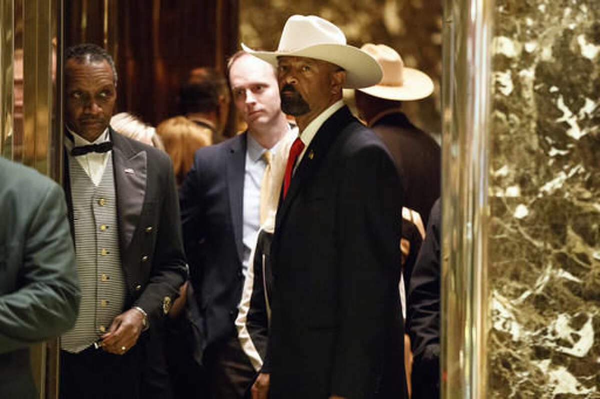 Milwaukee Sheriff David Clarke gets on an elevator after arriving at Trump Tower, Monday, Nov. 28, 2016, in New York. (AP Photo/Evan Vucci)