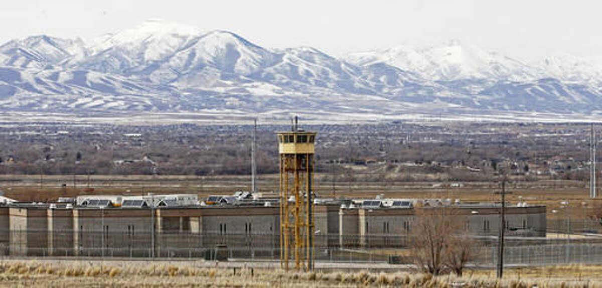 FILE - This Feb. 19, 2013, file photo shows the Utah State Prison in Draper, Utah. A new commission looking at redeveloping the site of Utah's aging state prison in Draper meets Monday, Nov. 21, 2016, to discuss next steps in planning for the 700-acre site and how officials can avoiding compounding traffic snarls on the nearby highway bridging the state's two biggest urban areas. (AP Photo/Rick Bowmer, File)