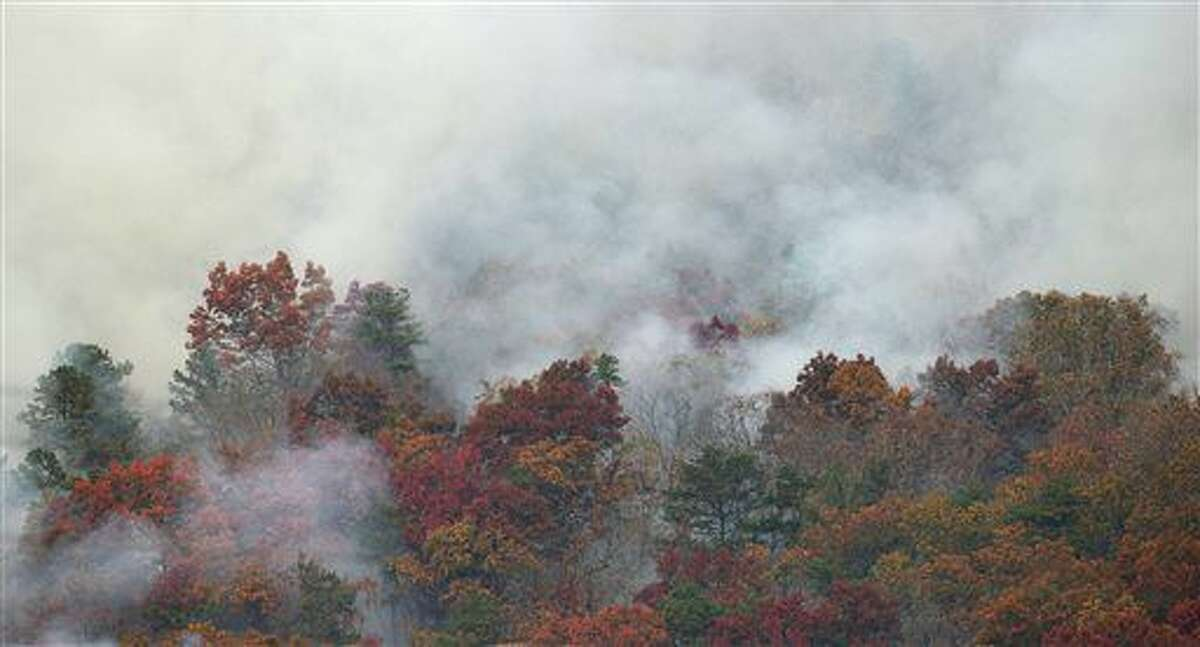 In this Monday, Nov. 14, 201 photo, smoke rises from wildfire on Clinch Mountain in Washington County near Mendota, Va. (Andre Teague/The Bristol Herald-Courier via AP)