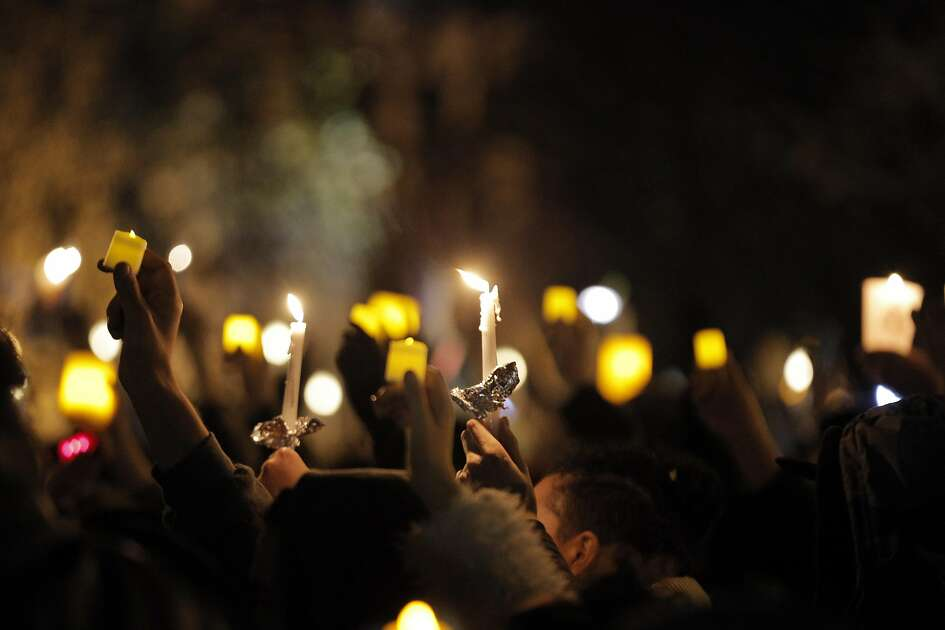 Participants hold their candles aloft during a vigil at Lake Merritt as recovery efforts continue following the Ghost Ship fire that has so far claimed 36 lives in Oakland, Calif., on Monday, December 5, 2016.