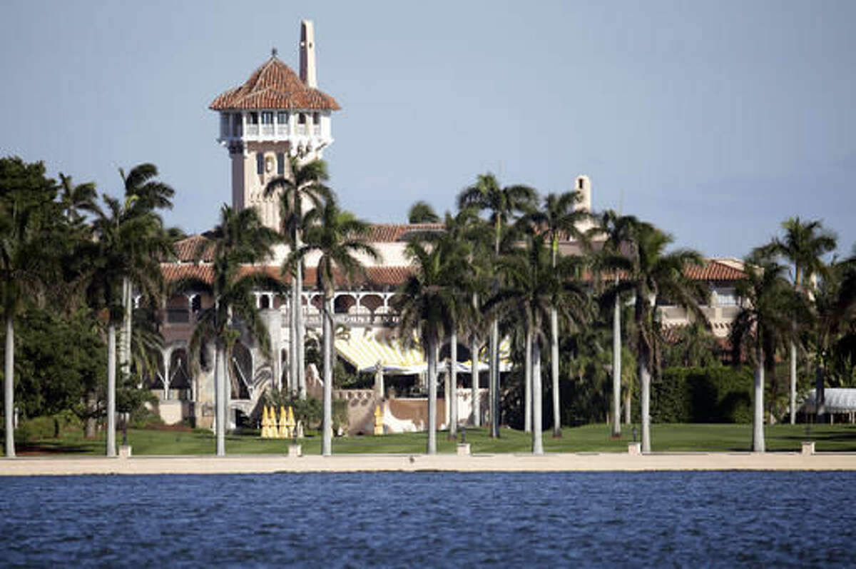 This Monday, Nov. 21, 2016, photo, shows the Mar-a-Lago resort owned by President-elect Donald Trump in Palm Beach, Fla. When Trump arrives at his Mar-a-Lago resort for Thanksgiving, it won't be the first time a president-elect has used Palm Beach as his vacation refuge. John Kennedy's family estate, known during his term as the Winter White House, is seven miles north at the other end of Ocean Drive. (AP Photo/Lynne Sladky)