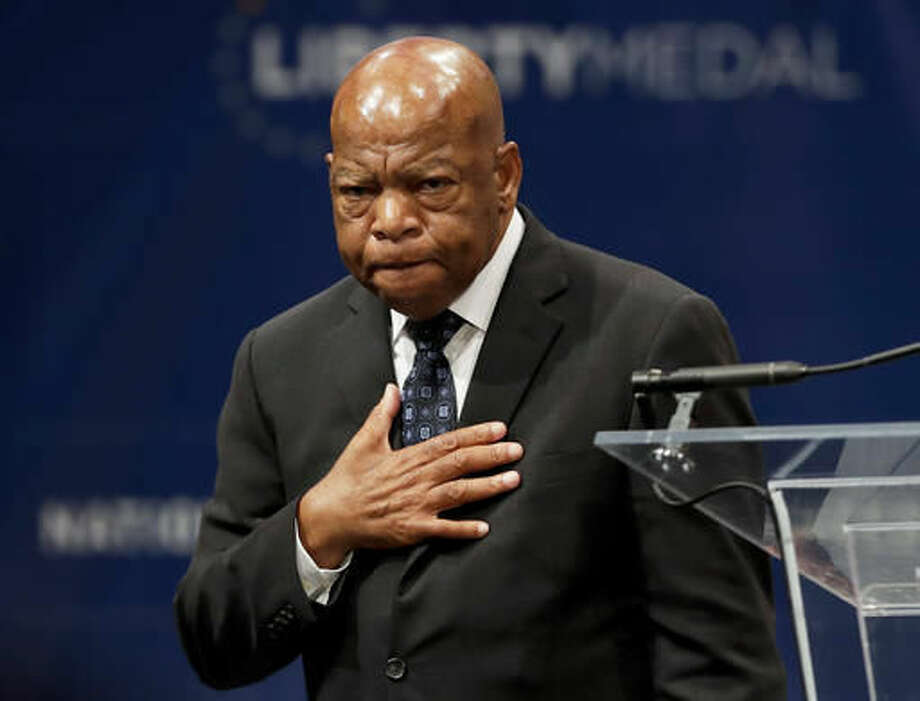 """FILE - In this Sept. 19, 2016 file photo, Rep. John Lewis, D-Ga., reacts after being presented with the Liberty Medal for his dedication to civil rights during a ceremony in Philadelphia. Colson Whitehead's """"The Underground Railroad"""" has won the National Book Award for fiction presented Wednesday night, Nov. 16, 2016, during a dinner ceremony at Cipriani Wall Street in Manhattan. Lewis, who collaborated on a trilogy of graphic novels titled """"March"""" about his civil rights activism, was among the winners of the young people's literature prize. (AP Photo/Matt Slocum, File) Photo: Matt Slocum"""