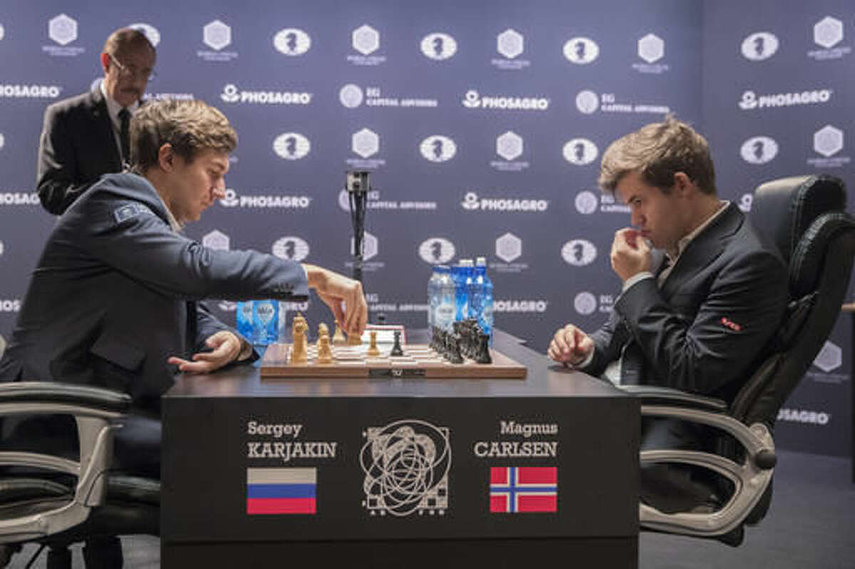 Sergey Karjakin, left, of Russia, makes a move against defending champion Magnus Carlsen, of Norway, during the tie breaker round of the World Chess Championship, Wednesday, Nov. 30, 2016, in New York. (AP Photo/Mary Altaffer)