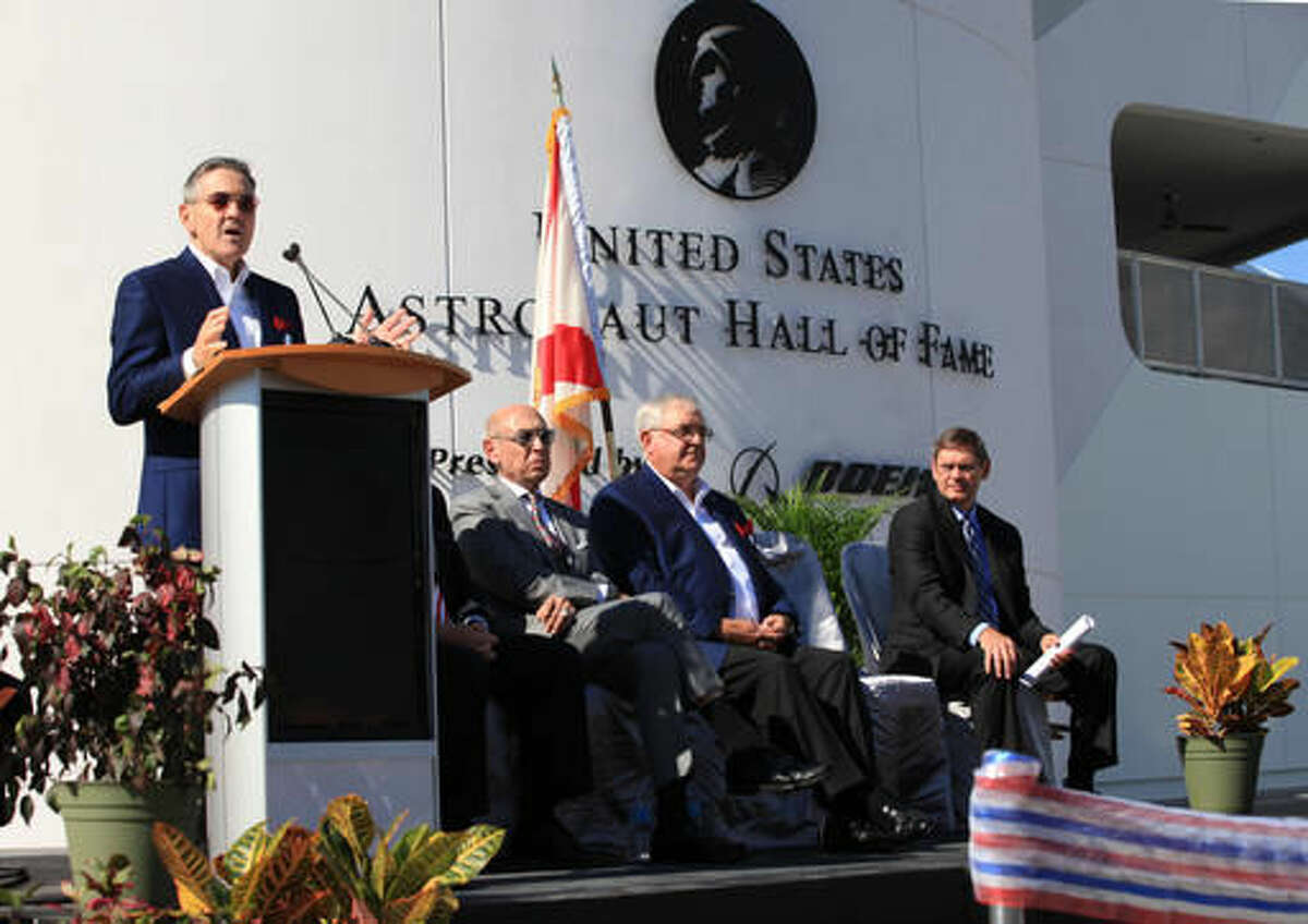 Former astronaut Robert Cabana, Kennedy Space Center's director, speaks during the ribbon cutting ceremony for the Heroes and Legends exhibit at the Kennedy Space Center Visitor Complex in Florida on Friday, Nov. 11, 2016. Seated from right to left are: Rick Abramson of Delaware North, the company that runs the visitor complex for NASA; retired shuttle astronaut Dan Brandenstein, board chairman for the Astronaut Scholarship Foundation; and John Elbon of Boeing, the sponsor of the exhibit. (Kevin O'Connell/NASA via AP)