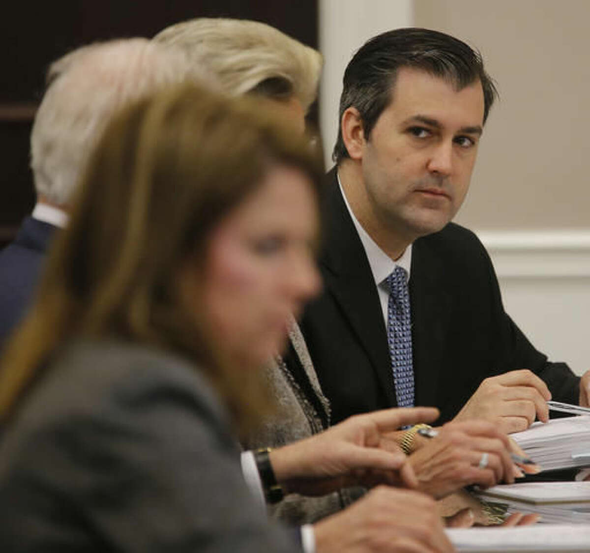 Former North Charleston Police Officer Michael Slager sits at the defense table during testimony in Slager's murder trial, Tuesday, Nov. 8, 2016, in Charleston, S.C. Slager is on trial facing a murder charge in the shooting death of Walter Scott, who was gunned down after he fled from a traffic stop. (Grace Beahm/Post and Courier via AP, Pool, File)