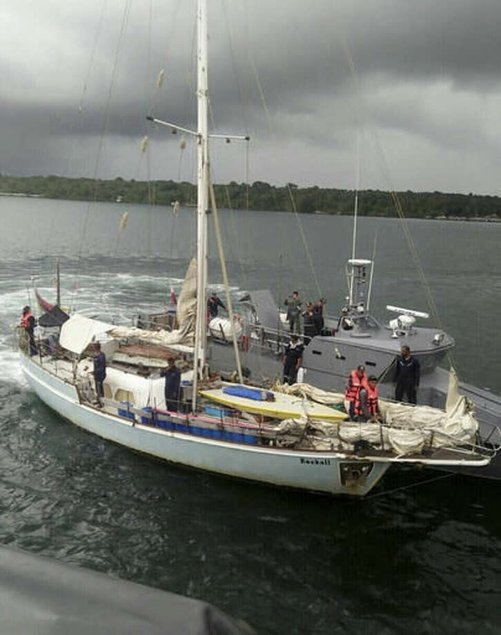 """In this photo provided by the Armed Forces of the Philippines Western Mindanao Command (WESMINCOM) and authorized for distribution by Army Maj. Filemon Tan Jr. Monday, Nov. 7, 2016, Philippine Navy board the yacht marked """"Rockall"""" after being found abandoned off the Sulu Sea in southern Philippines over the weekend. The Philippine military is verifying a claim by Abu Sayyaf militants that they have kidnapped a German man from the yacht and shot and killed his female companion, whose suspected body was found on the abandoned boat, military officials said Monday. Regional military spokesman Maj. Filemon Tan said Abu Sayyaf spokesman Muamar Askali had claimed the militants kidnapped Juegen Kantner and killed his companion while the couple were cruising off neighboring Malaysia's Sabah state. (WESMINCOM via AP) Photo: HOGP"""